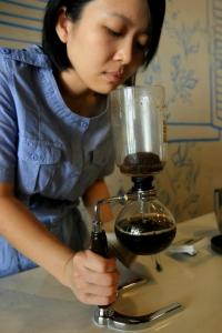 Ving making coffee in her Kuala Lumpur shop.