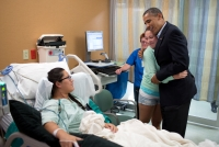 President Obama with survivors of the Aurora shooting.