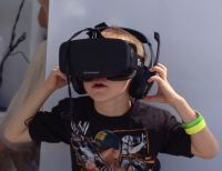 Boy wearing Oculus Rift HMD - On the Verge of Virtual, and Why Psychologists Should Care