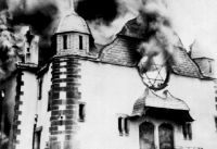 A synagogue burning on Kristallnacht, 1938