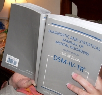Cover of Diagnostic and Statistical Manual of Mental Disorders - More Than 500 People Attend DSM-5 Symposium at APA