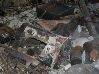 The remains of a sewing machine in a house after a wildfire.