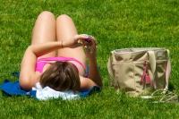 Texting while sunbathing. Photo by Ed Yourdon.