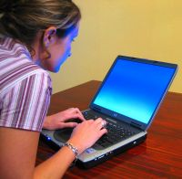 Woman typing on laptop2 - The Perils of Privilege: A Culture of Misogyny